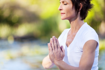 yoga meditation: middle age woman doing yoga meditation Stock Photo