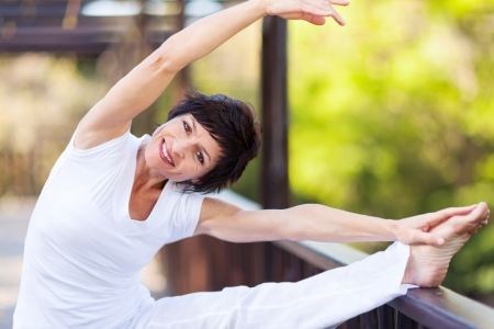 middle aged woman: active middle aged woman stretching