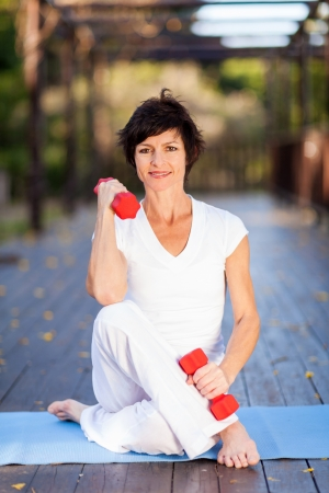 active lifestyle: active middle aged woman exercise with dumbbells