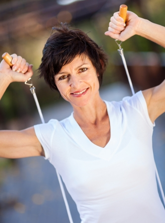 active middle aged woman with jumping rope photo
