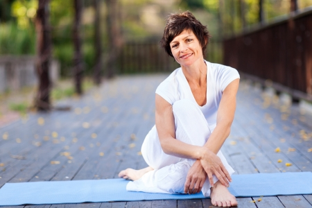middle aged women: fit middle aged woman relaxing after workout