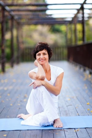 fit middle aged woman portrait outdoors photo