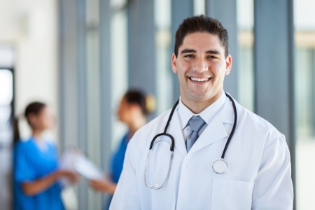 medical career: happy male medical doctor portrait in hospital