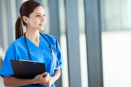 beautiful young female medical intern looking outside window Stock Photo - 15692951