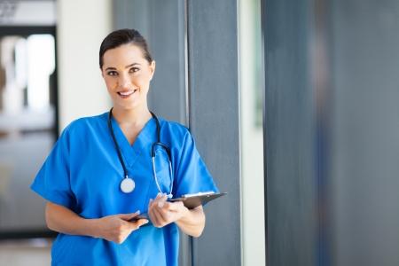 nurse clipboard: beautiful nurse portrait in hospital Stock Photo