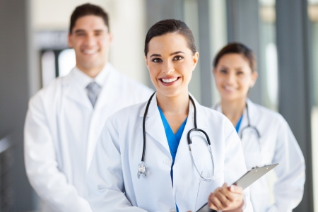 nurse uniform: grupo de m�dicos retrato trabajadores en el hospital Foto de archivo