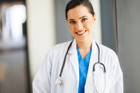 clinical staff: attractive female medical doctor portrait in office Stock Photo