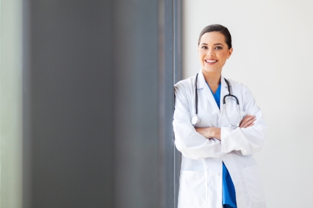 attractive young female medical doctor portrait in office photo