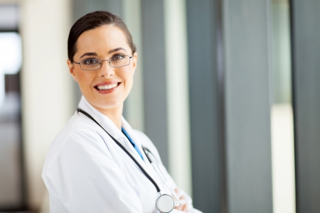 general practitioner: pretty female general practitioner portrait in office Stock Photo