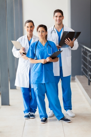 group of healthcare workers full length portrait photo