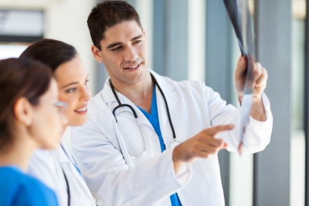 ct scan: group of medical workers looking at patients x-ray film Stock Photo