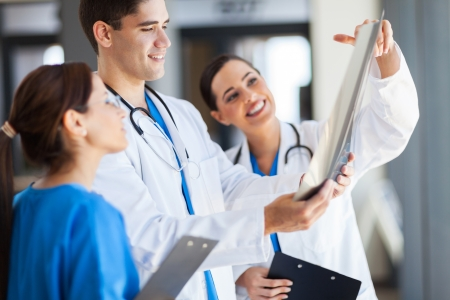 clinical staff: group of healthcare workers working together Stock Photo