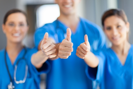 healthcare office: group of healthcare workers thumbs up Stock Photo