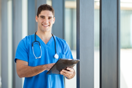 male nurse: happy male healthcare worker with tablet computer