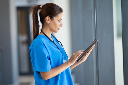 female nurse: female nurse using tablet computer in hospital  Stock Photo