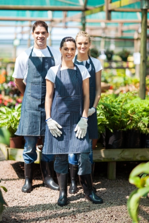 group gardeners portrait in greenhouse photo
