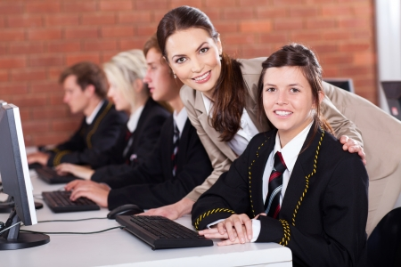 high school teacher and students in computer room Stock Photo - 15893311