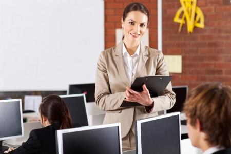 pretty female high school teacher portrait in computer room Stock Photo - 15893420
