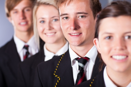 group of high school students in uniforms closeup portrait photo