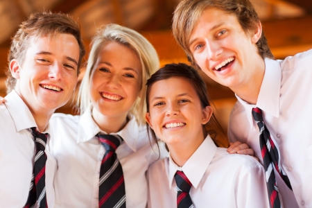 uniform student: group of happy high school students closeup