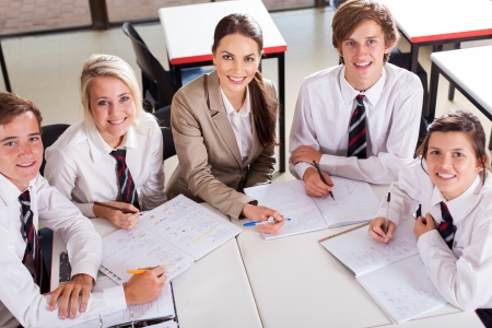 uniform student: overhead view of high school teacher and students in classroom Stock Photo