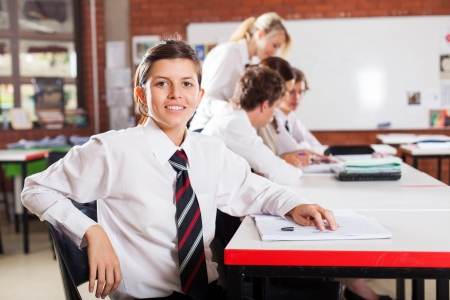 uniform student: cute female high school student in classroom Stock Photo