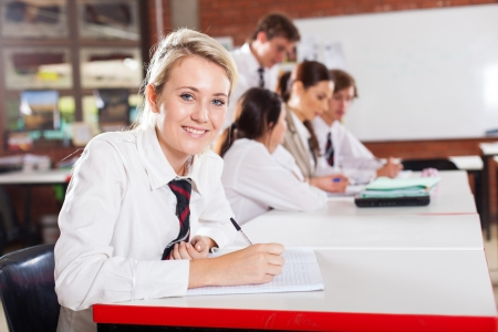 middle school girl student sitting in classroom Stock Photo - 15893454