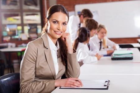 attractive female school teacher in classroom Stock Photo - 15893304