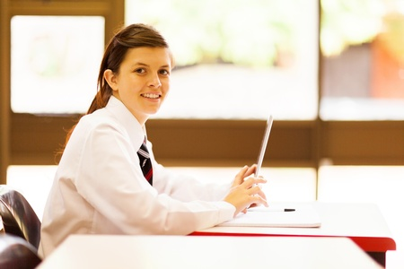 uniform student: female middle school student using tablet computer in classroom Stock Photo