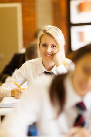 pretty high school girl in classroom photo