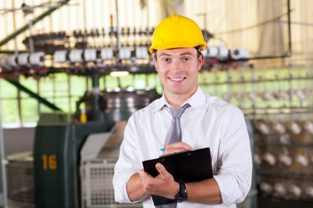 textile factory manager portrait in production area Stock Photo - 16013890