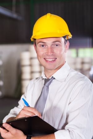 qc: portrait of handsome factory manager