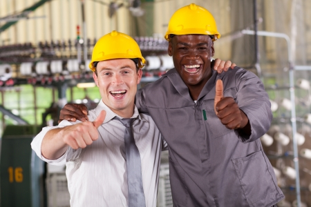 factory manager and worker thumbs up photo