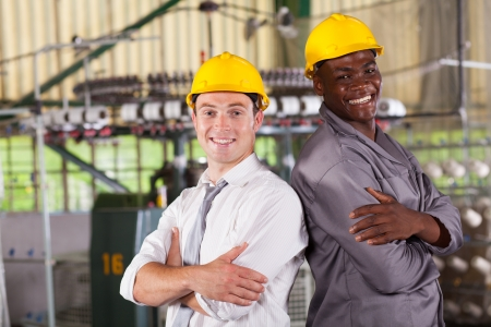 cloth manufacturing: happy factory manager and worker portrait Stock Photo