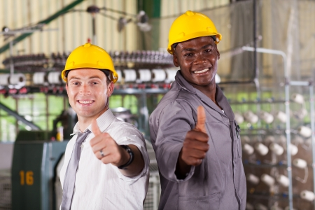 happy factory foreman and worker thumbs up photo