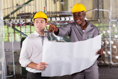 factory manager and worker discussing about production plan Stock Photo - 16013868