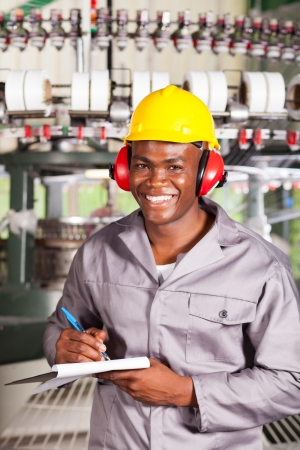 happy african textile factory worker portrait in front of weaving machine Stock Photo - 16013899