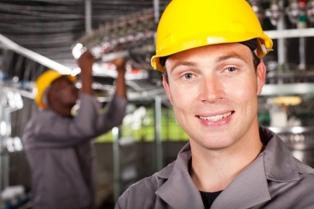 industrial worker closeup portrait in factory photo