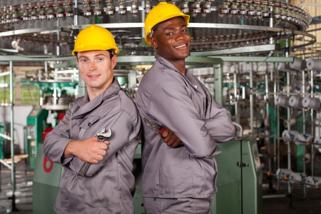 two textile industrial technicians portrait in factory Stock Photo - 16013861