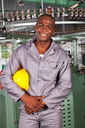 african american blue collar industrial worker in factory photo