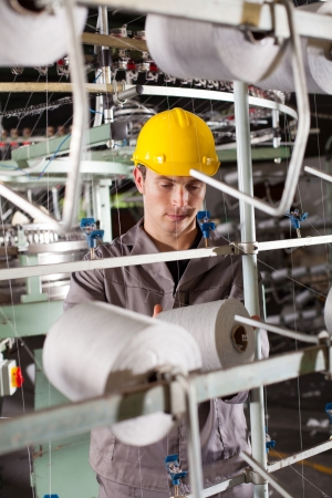 textile industrial worker working in factory photo