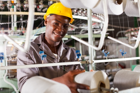 young african textile industry worker in factory Stock Photo - 16013889