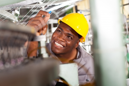 african american textile industrial quality controller at work photo