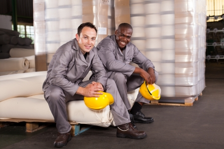 industrial worker: two textile factory workers relaxing during break Stock Photo