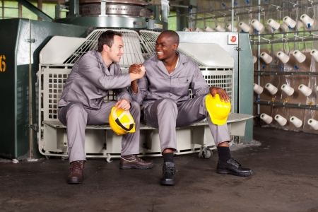 blue collar: textile industry blue collar workers brotherhood Stock Photo