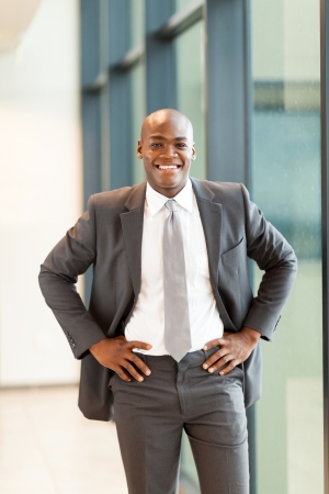 happy young african american businessman in office photo