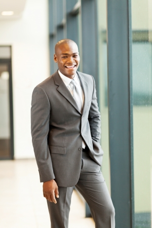 gray suit: handsome young african american businessman in office