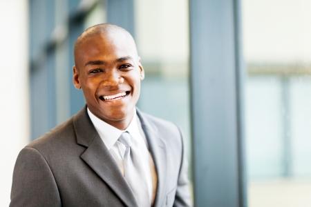 office windows: smart african american businessman in office