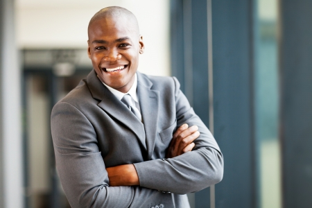 handsome modern african businessman in office photo