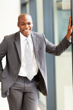 happy african american businessman in office photo